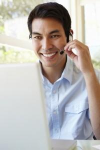 Filipino man using skype